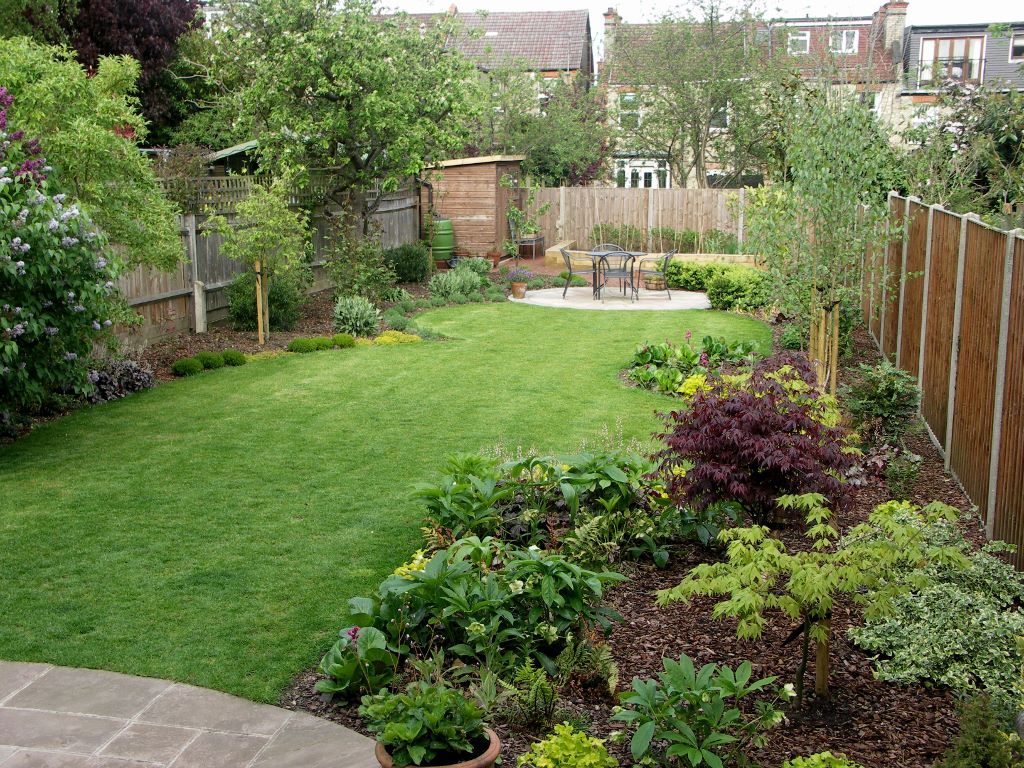curved lawns provide interest and invite a journey down the garden - Garden Design Long Narrow Plot