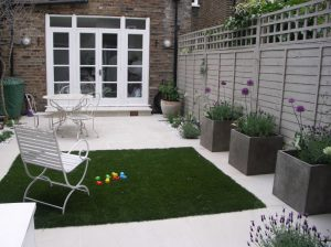 Patio garden with beige sandstone paving
