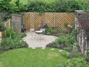 Patio shape echoes the smooth curves of the lawn