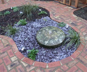 Millstone Water Feature in island bed