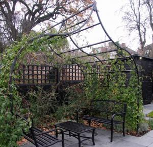 Finchley Garden - Ogee Arbour with rambling roses and seating